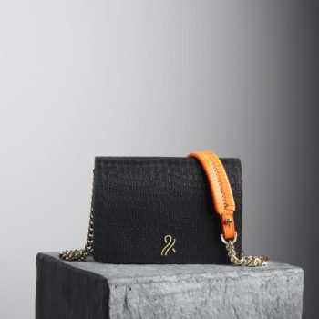 Black Mee Chain Bag with orange braided shoulder strap, illicia