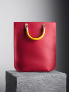 Cardinal Red Sophia Tote Bag with yellow woven handles, illicia