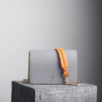 Graphite Mee Chain Bag with orange shoulder strap