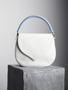 White leather shoulder bag with blue woven handle